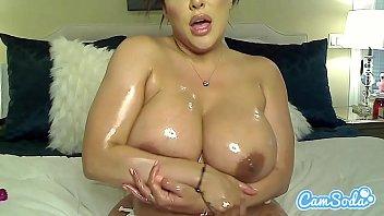 kiara mia oils her big titties and ass xxncom before masturbating.