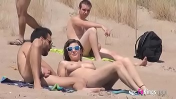 sol fucks a tubydy com guy in a beach surrounded by voyeurs