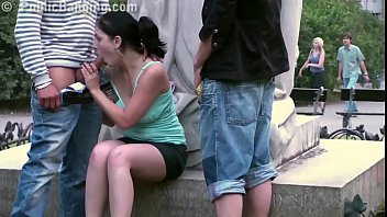 cute teen girl fucked by 2 guys in public in shoplifter com center of the city by famous statue