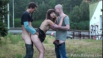 a girls strips naked cute chick is fucked hard in public threesome sex