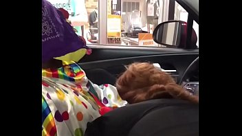 clown gets dick topless boobs sucked while ordering food