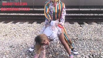 clown fucks desi lady com girl on train tracks