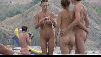 beautiful fresh beeg com faced teen plays at the beach nude