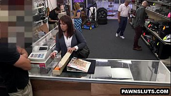 brunette tries to sell bpxxx some cards to the pawn shop