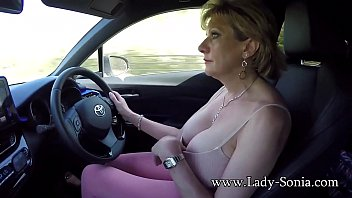 mature blonde lady sonia plays xxx vd com with her tits while driving