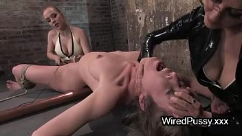 bdsm sexclips com brunette babe waxed and t. with electricity in femdom scene